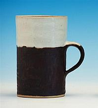 Dame Lucie Rie and Hans Coper a tall stoneware mug,