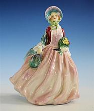 A Royal Doulton figurine 'Honey', by Leslie Harradine, in billowing dress, polka dot shawl and bonnet,