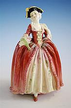 A Royal Doulton figurine 'Camille', HN1586 by Leslie Harradine, circa 1940, ballooned skirt below a corseted top,