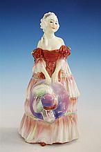 A Royal Doulton figurine 'Veronica', HN1517 by Leslie Harradine, in a layered dress, holding a feathered hat, 8in. (20.3cm.) high.