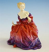 A Royal Doulton figure 'Lady Fayre', HN1265 by Leslie Harradine, 1930s, seated in a beautifully coloured flowing dress,