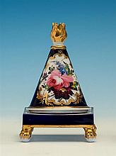 An early 19th century porcelain pastille burner probably Chamberlain's Worcester, the cover of conical form with flame finial,