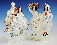 A Staffordshire figural group 19th century, depicting a Scottish couple in traditional dress,