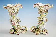 A pair of Continental cornucopia spill vases 19th century, applied floral decoration on white glaze body, on shaped supports,