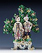 A rare Bow porcelain figure of a Turk and companion c.1765, she wearing a helmet and an ermine edged pale yellow cloak,