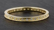 A Clogau 9ct Welsh gold and diamond full eternity ring