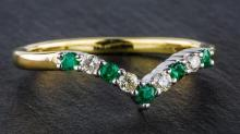 A 9ct yellow gold, emerald and diamond wishbone ring set with five round cut emeralds divided by four brilliant cut diamonds,