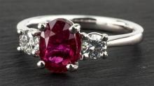 An 18ct white gold, ruby and diamond three stone ring