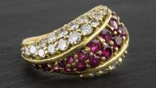 An 18ct yellow gold, ruby and diamond dress ring