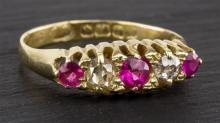 An 18ct gold, ruby and diamond five stone ring