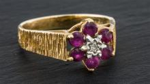 A vintage 9ct gold, ruby and diamond cluster ring London 1976,
