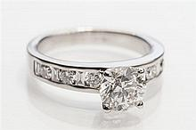 An 18ct white gold and diamond ring the central 1.0 carat round brilliant cut diamond with HRD Certificate, VS2, colour G,