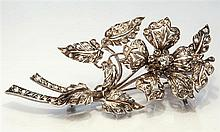 A Victorian gold and diamond set trembleuse floral spray brooch probably French, hallmarked, the pin stamped '18K',
