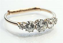 An 18ct yellow gold and diamond five stone ring the five graduated old cut stones weighing a total of approx. 0.85 carats,