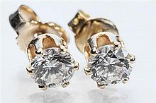 A pair of 18ct gold and diamond stud earrings the claw set diamonds weighing approx. 0.25 carats each. (2)
