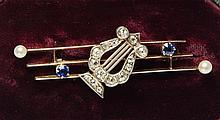 An Art Deco style gold, diamond, sapphire and pearl 'music' brooch 1920s, the delicate three bar brooch formed as bars of music,