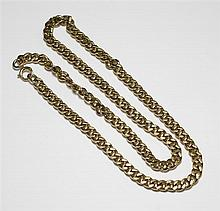 A 9ct gold flat oval curb link chain necklace 20in. (51cm.) long.