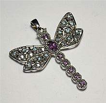 A 9ct white gold, amethyst, diamond and topaz dragonfly pendant with open filigree work body and wings,