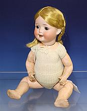 A German bisque head doll by Heubach Koppelsdorf 1910-20s, impressed marks 'Heubach Koppelsdorf 300. 0. Germany',