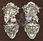 A pair of John Bevington porcelain wall pockets. circa 1860, in the Meissen style,