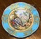 A Sevres style handpainted cabinet plate 19th century, the well painted and enamelled with a young dandy at rest beside a lake,