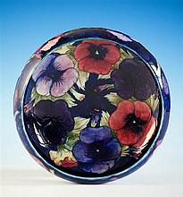 A Moorcroft bowl first quarter 20th century, steeply curved shallow bowl, pansy decoration on cobalt blue ground,