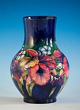 A Moorcroft vase 1940s, ovoid form, Walter Moorcroft frilled slipper orchid pattern on cobalt blue ground,