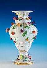 A Meissen fruit and flower encrusted vase late 19th / early 20th century, underglaze blue crossed swords mark,