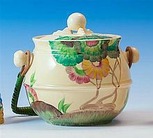 A Clarice Cliff Bizarre 'Aurea' pattern biscuit barrel c.1934, shape no. 335, the cauldron shaped biscuit barrel in honey glaze,