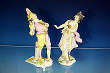 A pair of Meissen porcelain figures of a Harlequin and Columbine late 19th century, with blue crossed swords marks,