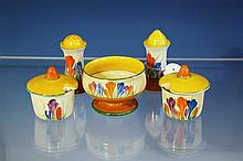 A matched four piece Clarice Cliff Bizarre 'Crocus' pattern cruet set comprising a pair of 'Muffineer' salt and pepper castors,