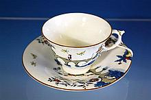 A Royal Worcester cup and saucer decorated with oriental scenes,