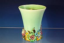 A Clarice Cliff vase 'My Garden' series, flared rim tapering to relief floral base on turquoise ground, 6¾in. (17cm.) high.