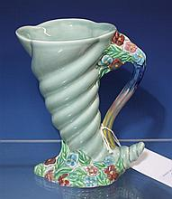A Clarice Cliff jug from the 'My Garden' series, spiral cornucopia form, floral base and handle, lobed rim,