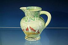 A Clarice Cliff jug Silver Birch pattern, green glazed, ribbed baluster from body, on slightly flared base,