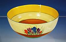 A Clarice Cliff bowl Autumn Crocus pattern, deep bowl with yellow and green circle interior decoration, toffee circle to base,
