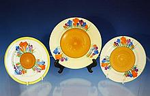 Three Clarice Cliff saucers Autumn Crocus pattern, from 5¾in. (14.5cm.) to 7in. (17.8cm.) diameter, black Wilkinson mark to bases. (3)