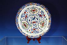 A Bristol Delft polychrome charger mid-18th century, painted in blue,