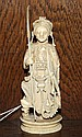 A Japanese carved ivory chess piece 19th century, in the form of a warrior, standing on an oval base, 4.25in. (11cm.) high.