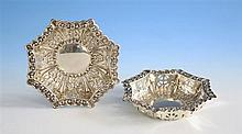 A pair of Edwardian pierced silver bon-bon dishes Thomas Hayes, Birmingham 1907, of octagonal form with extensive repoussé floral,