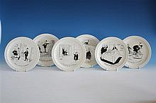 A set of six plates by Jacques Faizant 1950s, by Faiencerie de St Amand, in original oval box with corresponding label,
