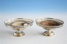 A pair of George V Art Deco style silver bon-bon dishes Mappin & Webb, Birmingham 1926, of shallow circular urn form,
