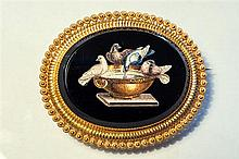 A fine 19th century Italian gold and micro-mosaic pendant brooch the oval black onyx plaque with bevelled edge,