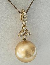 An 18ct gold pearl and diamond pendant