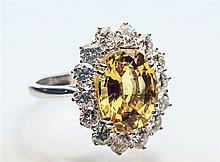 An 18ct white gold yellow sapphire and diamond cluster ring