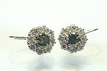 A pair of fancy coloured diamond cluster earrings first half 20th century, the central olive green old cut diamonds,