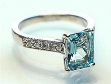 An 18ct white gold aquamarine and diamond ring