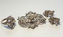 An Edwardian gold, silver, diamond and pearl floral spray brooch probably Continental,