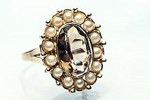 A 15ct gold, topaz and seed pearl cluster ring early 20th century,
