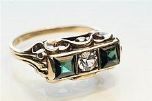 An 8ct gold, emerald and diamond three stone ring Continental, early 20th century,